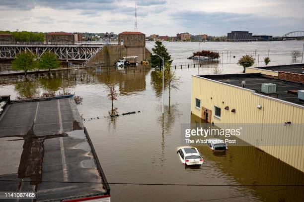 Flood waters surround area businesses near the main breach in the Mississippi River in Davenport Iowa on Friday May 3 2018