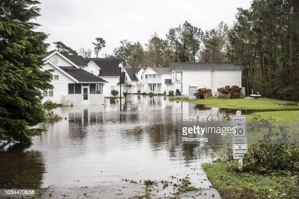 Flood waters surround homes after Hurricane Florence hit in Wilmington North Carolina US on Saturday Sept 16 2018 In flooded communities emergency...