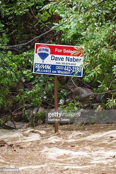 CONTENT] Flood waters surround the for sale sign of a house neighboring Boulder Creek Fortunately it appears the house was fine and did end up selling