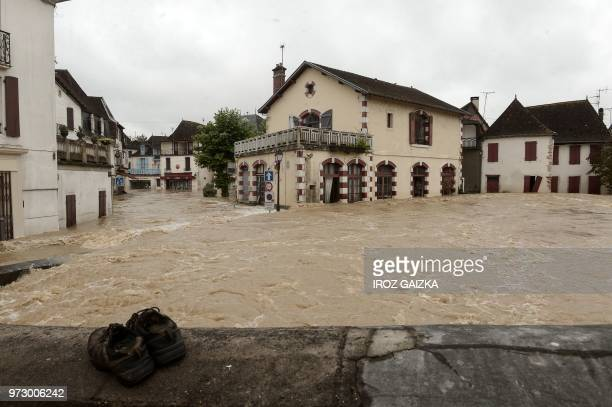 Flood waters sweep through the streets following heavy rains in SaliesdeBearn south western France on June 13 2018