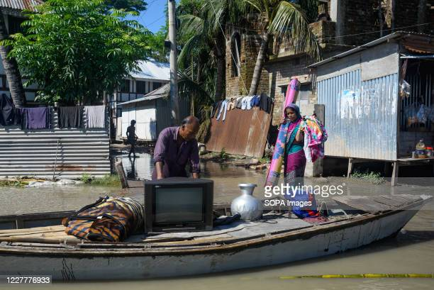 Flood-affected family is moving their household belongings. The flood situation is worsening in Munshiganj. Due to the heavy rain, the water level of...
