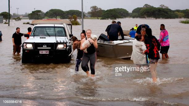 Floodaffected people are evacuated from Townsville on February 4 as the recent downpour in Australia's tropical north has seen some areas get a...