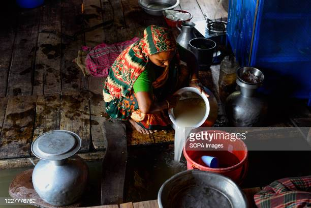 Flood-affected woman seen cooking inside her flooded house in Munsiganj. The flood situation is worsening in Munshiganj. Due to the heavy rain, the...