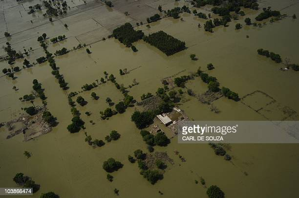Flooded areas of Southern Punjab are seen in this aerial view from a United Arab Emirates Chinook helicopter delivering aid provided by Oman and...