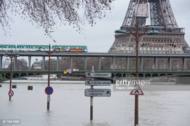 Flooded banks of the river Seine with eiffel Tower in the background are seen after days of almost non stop rain on January 29 2018 in Paris France...