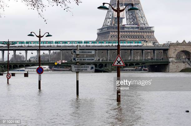 Flooded banks of the River Seine with the Eiffel Tower in the background are seen after days of almost nonstop rain caused flooding in the country on...