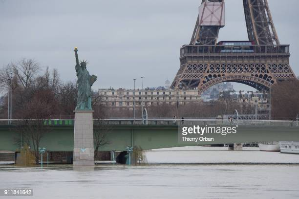 Flooded banks of the river Seine with the Statue of Liberty and The Eiffel Tower are seen after days of almost non stop rain on January 29 2018 in...