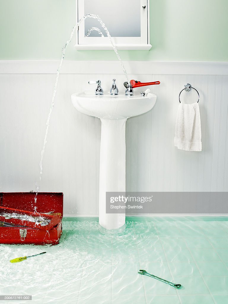 Flooded Bathroom With Plumbing Tools Stock Photo | Getty ...