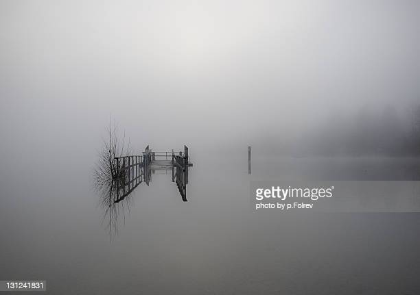 Flooded bridge with morning fog