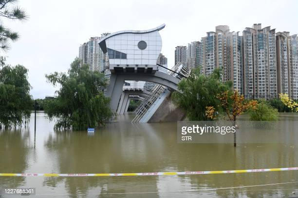 Flooded buildings are seen in Nanjing, in China's eastern Jiangsu province on July 19, 2020. - Vast swathes of China have been inundated by the worst...