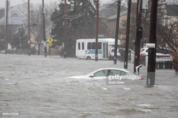 A flooded car sits in Hough's Neck due to a strong coastal storm on March 2 2018 in Quincy Massachusetts A nor'easter hit the east coast on Friday...