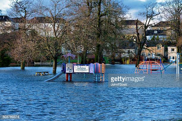 flooded children's play area in scottish park - johnfscott stock pictures, royalty-free photos & images