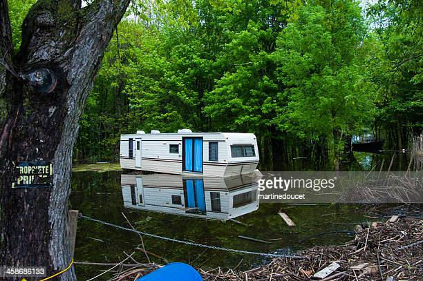 """flooded deserted mobile home. - """"martine doucet"""" or martinedoucet stock pictures, royalty-free photos & images"""