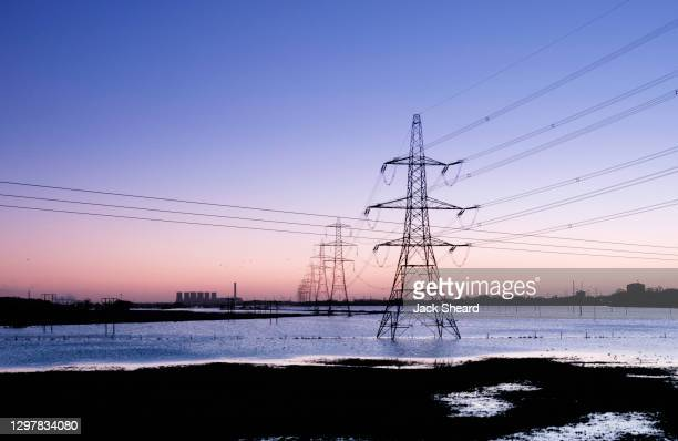 flooded electricity pylons - extreme weather stock pictures, royalty-free photos & images