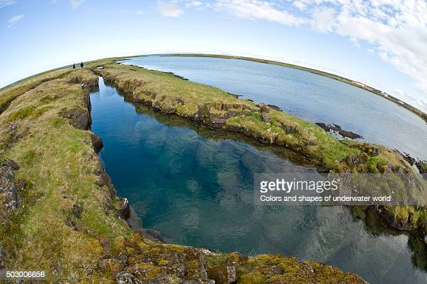 flooded fissures at asbirgi - plate tectonics stock photos and pictures