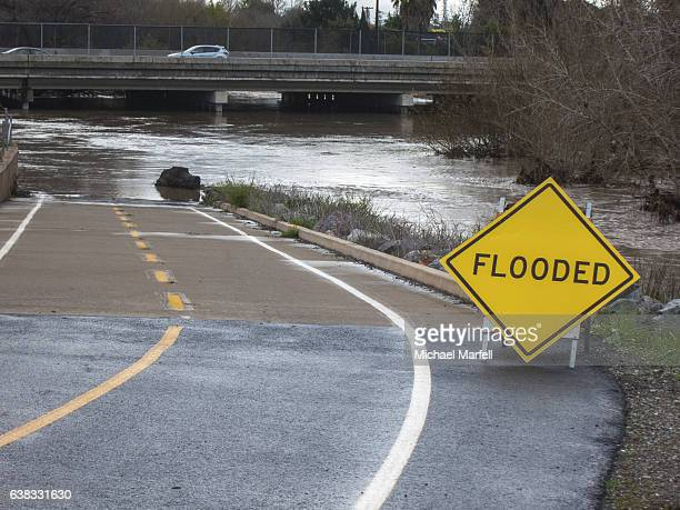 flooded guadalupe river san jose, ca. 1-11-2017 - california flood stock photos and pictures