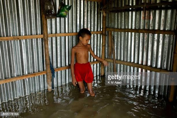 SARIAKANDHI BOGRA DHAKA BOGRA BANGLADESH A flooded home at Sariakandhi Bogra Bangladesh 15 August 2017 Peoples suffering continues as many of them...