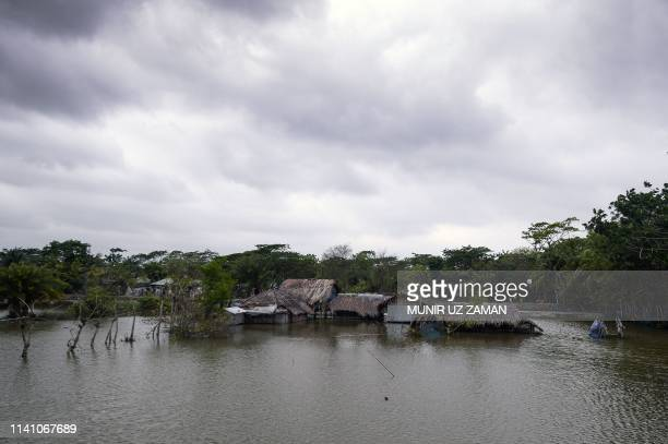Flooded homes are pictured after an embankment was hit by rising water in Khulna on May 4 as Cyclone Fani reached Bangladesh Cyclone Fani one of the...
