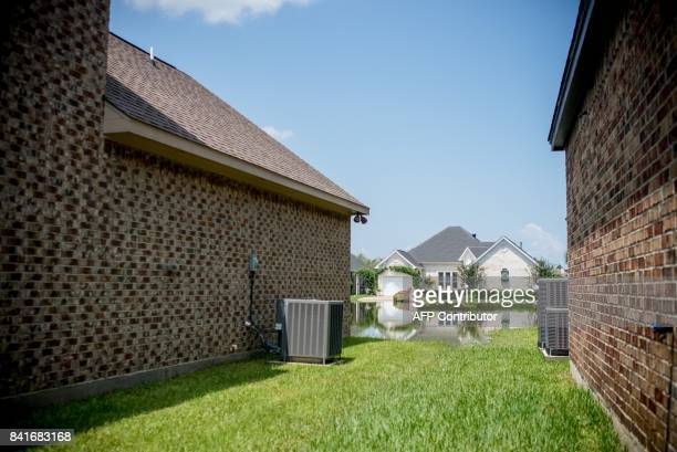 Flooded homes are seen in Port Arthur Texas on September 1 2017 Stormweary residents of Houston and other Texas cities began returning home to assess...