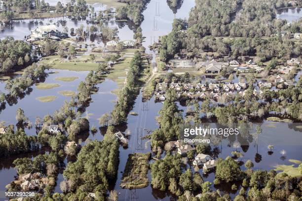 Flooded homes are seen in this aerial photograph taken above Wallace North Carolina US on Friday Sept 21 2018 Record floods cover much of eastern...