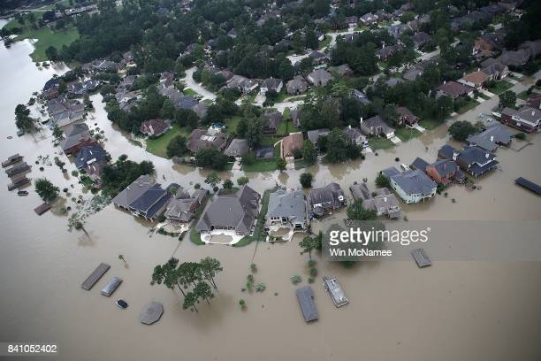 Flooded homes are shown near Lake Houston following Hurricane Harvey August 30, 2017 in Houston, Texas. The city of Houston is still experiencing...