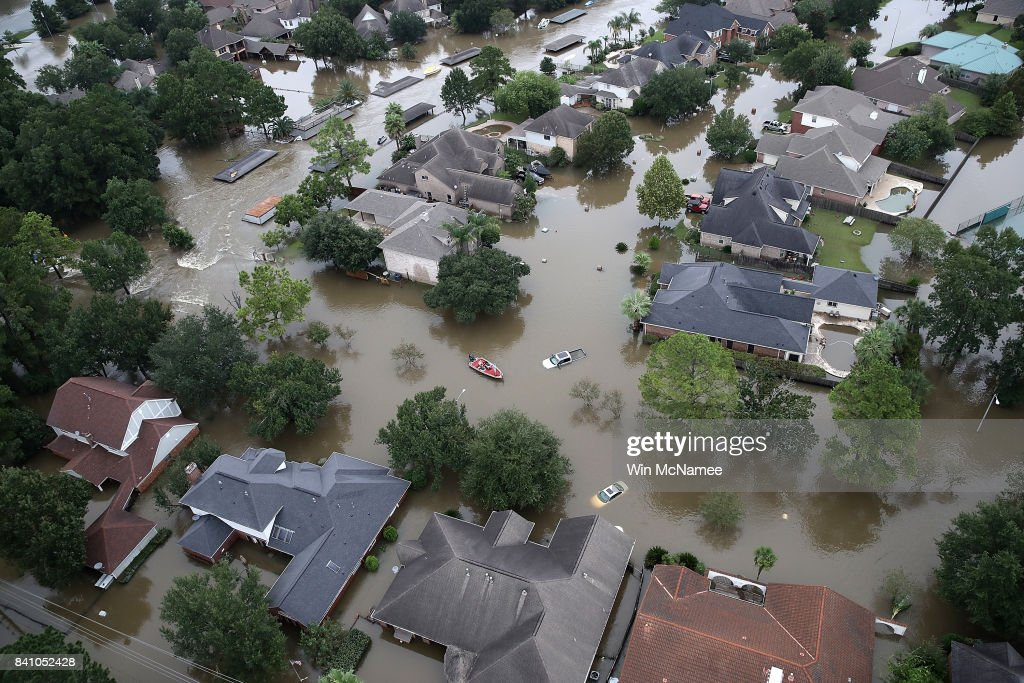 Flooded homes are shown near Lake Houston following Hurricane Harvey August 30, 2017 in Houston, Texas. The city of Houston is still experiencing severe flooding in some areas due to the accumulation of historic levels of rainfall, though the storm has moved to the north and east.