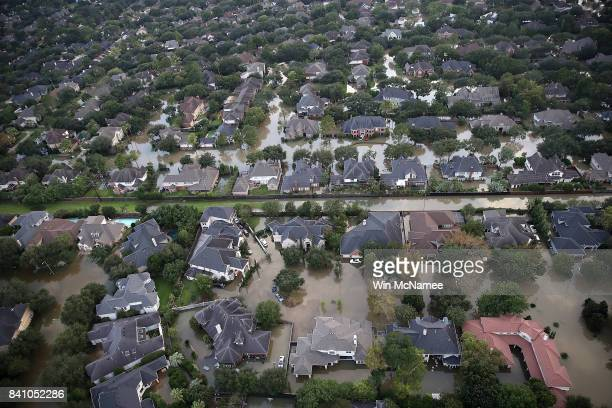 Flooded homes are shown near the Barker reservoir following Hurricane Harvey August 30 2017 in Houston Texas The city of Houston is still...