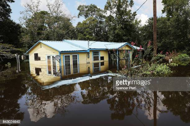 Flooded homes stand in downtown Hartburg as Texas slowly moves toward recovery from the devastation of Hurricane Harvey on September 5, 2017 in...