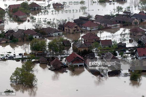 flooded house aerial view - flooding stock photos and pictures