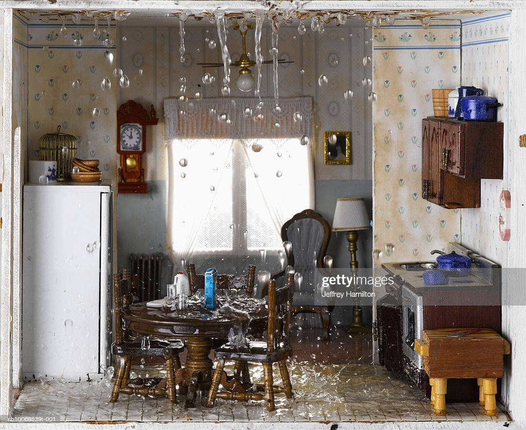 Flooded House And Ceiling Leaking Water Into Kitchen Stock