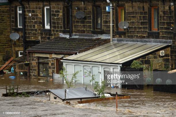 TOPSHOT Flooded houses are pictured in Mytholmroyd northern England on February 9 after the River Calder burst its banks as Storm Ciara swept over...