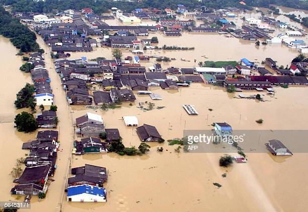 Flooded houses are shown at Hat Yai the largest city in southern Thailand during the floods 19 December 2005 The death toll from floods in southern...