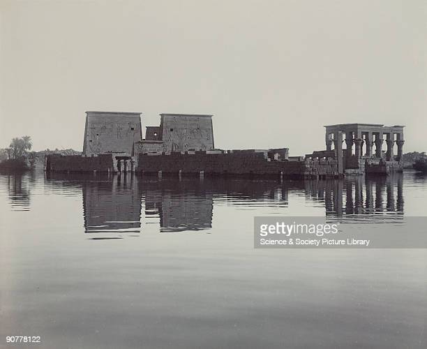 Flooded landscape with Ancient Egyptian temples from a series of photographs showing the building of the Aswan Dam In the late 19th century the...