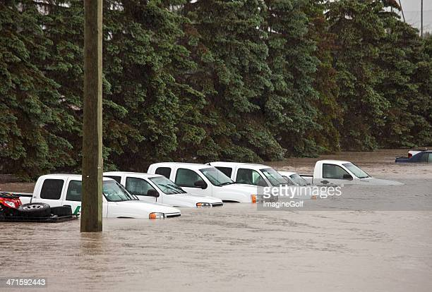 Flooded Parking Lot and Damaged Vehicles