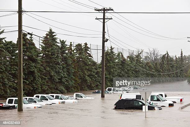 flooded parking lot and damaged vehicles - calgary alberta stock pictures, royalty-free photos & images