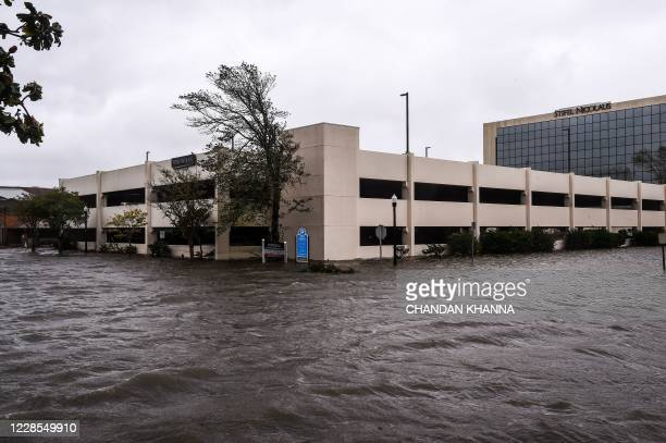 TOPSHOT Flooded parking lot is seen during Hurricane Sally in downtown Pensacola Florida on September 16 2020 Hurricane Sally barrelled into the US...