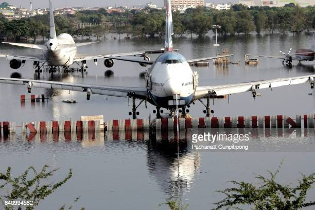 Flooded Planes after a Natural Disaster at Donmuang International Airport, Bangkok, Thailand