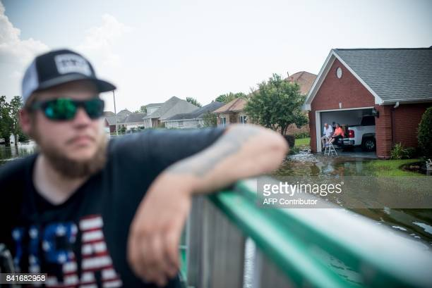 A flooded residential road as seen from a rescue monster truck in Port Arthur Texas on Thursday September 1 2017 Stormweary residents of Houston and...