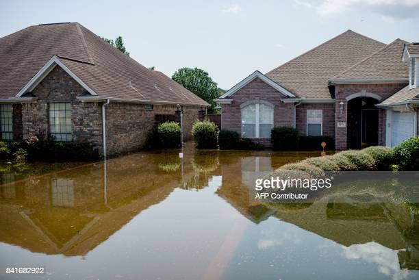 A flooded residential road in Port Arthur Texas Thursday September 1 2017 Stormweary residents of Houston and other Texas cities began returning home...