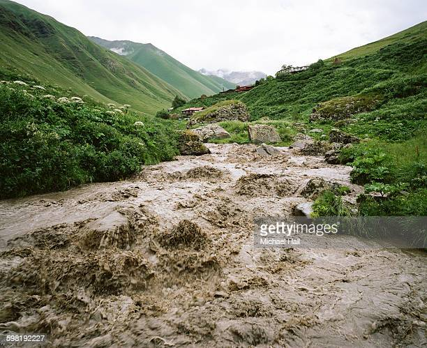 flooded river, topsoil loss - soil erosion stock photos and pictures
