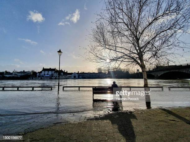 flooded riverbank in staines, middlesex, uk - riverbank stock pictures, royalty-free photos & images