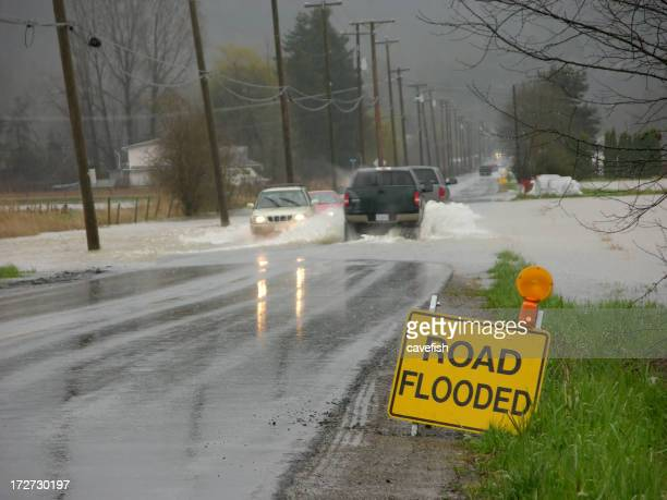 Flooded Road with Sign