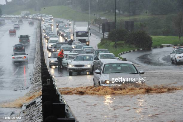 flooded roads - torrential rain stock pictures, royalty-free photos & images