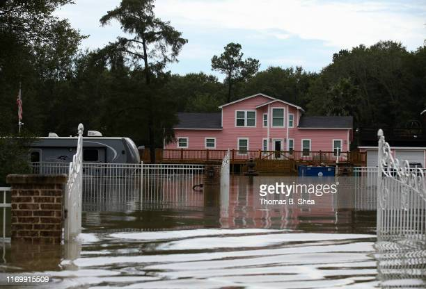 A flooded RV and house is seen on highway 124 on September 20 2019 in Beaumont Texas Gov Greg Abbott has declared much of Southeast Texas disaster...