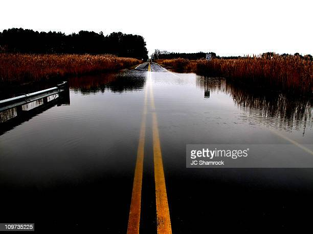 flooded silver run road - flooding stock photos and pictures