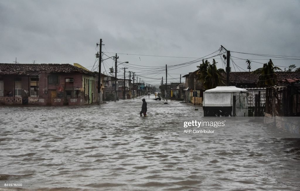 A flooded street during the passage of Hurricane Irma in Caibarien, Villa Clara province, 330km east of Havana, on September 9, 2017. Irma's blast through the Cuban coastline weakened the storm to a Category Three, but it is still packing 125 mile-an-hour winds (205 kilometer per hour) and was expected to regain power before hitting the Florida Keys early Sunday, US forecasters said. The Cuban government extended its maximum state of alert to three additional provinces, including Havana, amid fears of flooding in low-lying areas. /