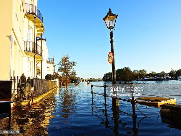 flooded street in chiswick against sky - flooding stock photos and pictures