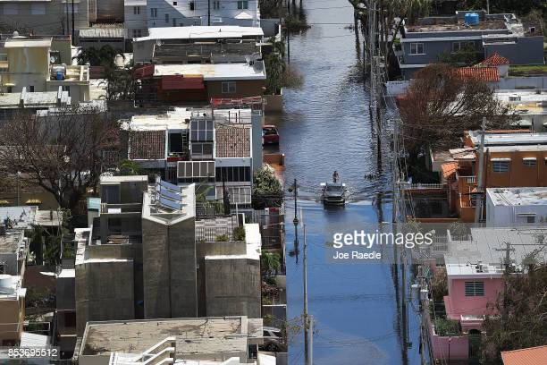 A flooded street is seen as people deal with the aftermath of Hurricane Maria on September 25 2017 in San Juan Puerto Rico Maria left widespread...