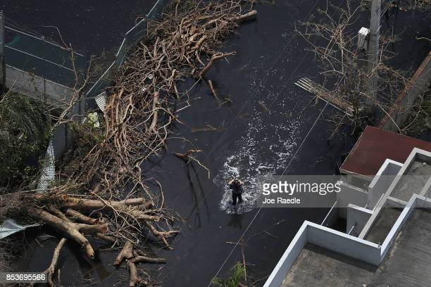 Flooded street is seen as people deal with the aftermath of Hurricane Maria on September 25, 2017 in San Juan Puerto Rico. Maria left widespread...