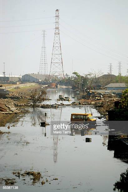 A flooded street is seen in front of power lines in the heavily damaged Ninth Ward September 12 2005 in New Orleans Louisiana Rescue efforts and...